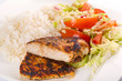 Roasted chicken breast with salad and rice