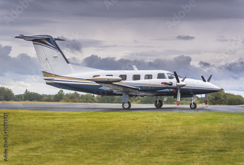 Private propeller plane parking at rural airport