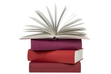 Bücherstapel mit aufgeschlagenes Buch