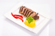 Roasted duck breast with potatoes and red peppers