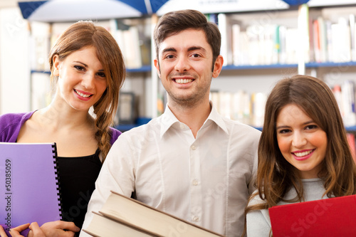 Smiling young students in a library