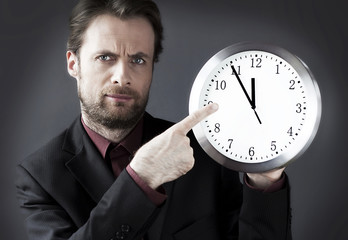Strict boss indicates a deadline hour on the clock
