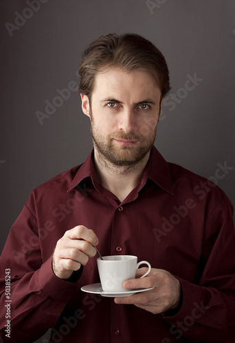 Forty years old business man drinking morning coffee