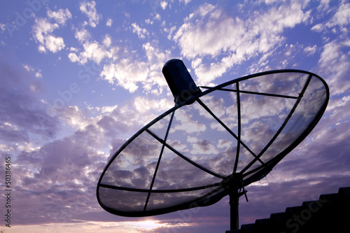 Satellite dish in sunrise