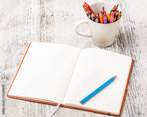 Colorful pencils and notebook