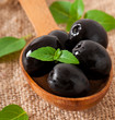 Black olives on a wooden table