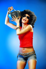 Happy tanned woman enjoying music holding tape recorder.