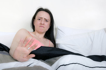 woman in bedroom looking disgusted