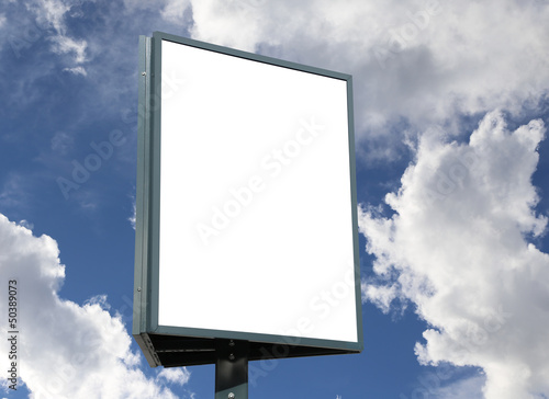 Large blank, empty, white billboard screen, on cloudy sky