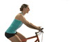 Young woman biking profile shot on white background.