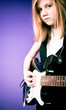 Girl playing the electric guitar