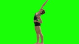 ung woman doing a modern dance piece in front of a green screen