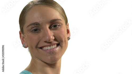 Young woman smiling to the camera in front of white background.
