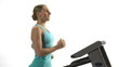 Young woman running on treadmill. White background.