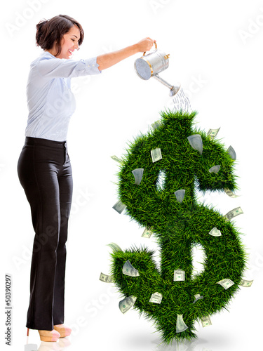Business woman watering money plant