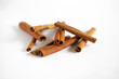 Cinnamon bark sticks, curled, isolated on white