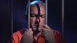 Man behind bars reflecting on his crime