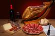 Different spanish embutidos: jamon, chorizo, salami, cheese