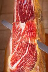 Slicing Spanish jamon iberico (ham)