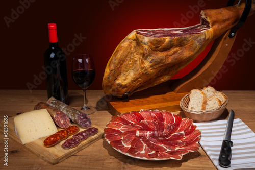 Different spanish embutidos: jamon, chorizo, salami, cheese