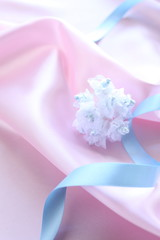 ribbon on pink silk for