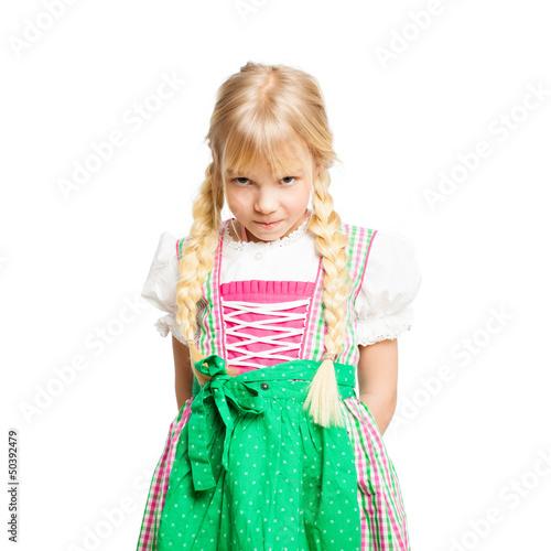 bockiges kleines Mädchen im Dirndl