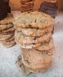 Stack of chocolate chip cookies on display