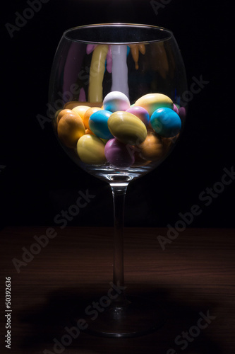 Easter Eggs in a glass of wine - 50392636