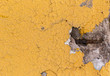 Details of a concrete yellow divider wall falling apart