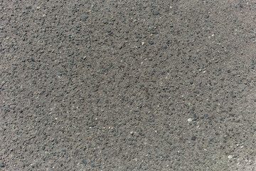 Textured asphalt with embeded rocks