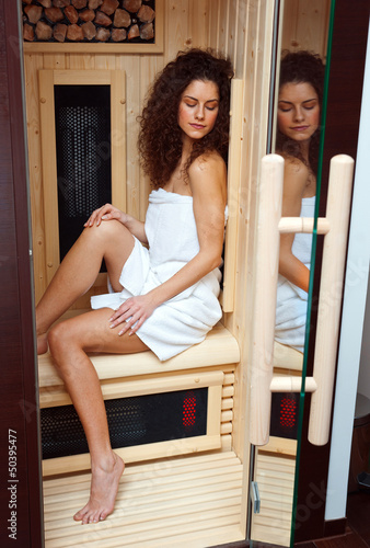 woman in compact sauna