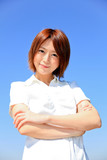 Shirt / Smile / Beautiful Office Lady with folded arms/ Blue SKY