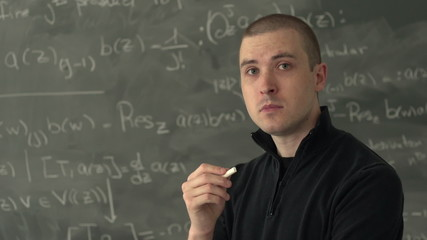 Proud teacher standing in front of chalk board