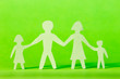 Paper family on green background