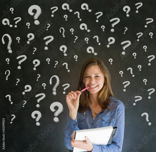 Thinking business woman with chalk question marks