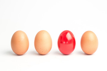 Four eggs in a row with one red one