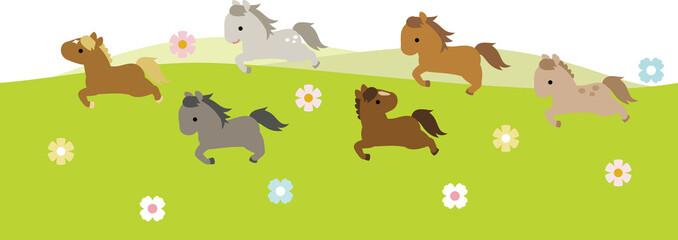 草原を走る馬の群れ