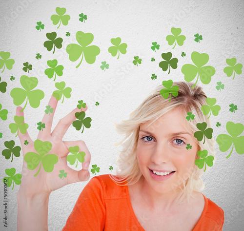 Blonde giving ok symbol for st patricks day