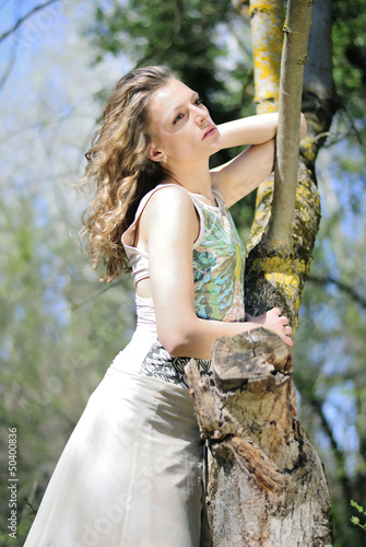 beautiful girl in green wood by summer