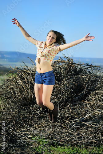 beautiful girl in shorts and hat on grapevine