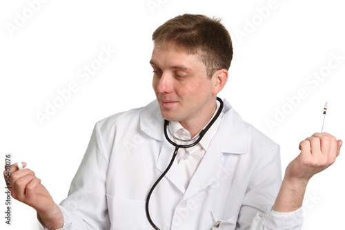 doctor holding and looking at a syringe  isolated on white backg