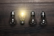 glowing bulb uniqueness concept on wooden background