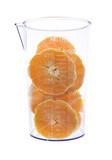 Sliced fresh orange in graduated measure