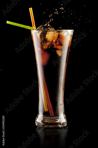 fresh cola juice and ice cubes splash in a glass - 50405280