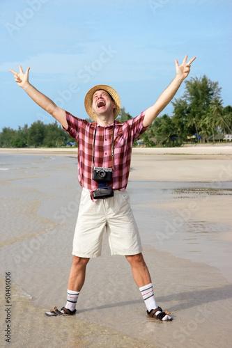 happy tourist on beach