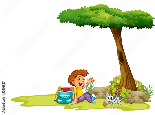 A boy and his cat under the tree