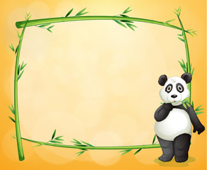 A panda standing at the right side of a bamboo frame