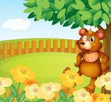 A bear standing near the flowers