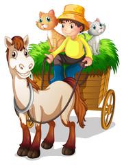 A farmer riding in a strawcart with his farm animals