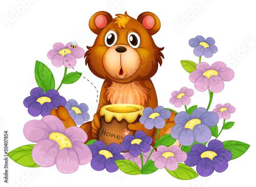 A bear holding a honey in the flower garden
